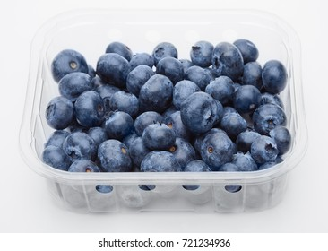 Fresh healthy organic blueberry in  plastic container on white background