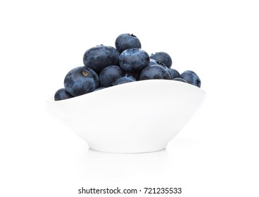 Fresh healthy organic blueberry in white bowl on white background