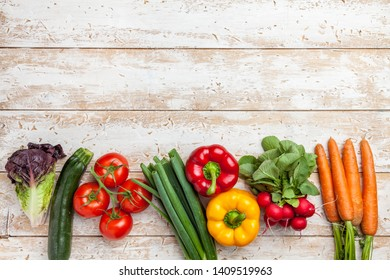 Fresh and healthy organic vegetables on a rustic background