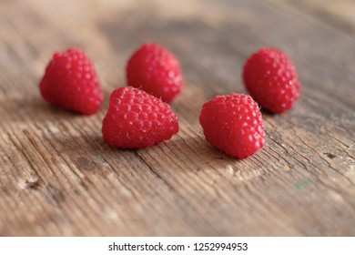 Fresh healthy raspberries on wooden table
