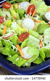 Fresh healthy salad made with fresh lettuce cherry tomatoes and more