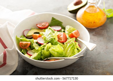 Fresh and healthy salad with romaine, radishes, cherry tomato and avocado