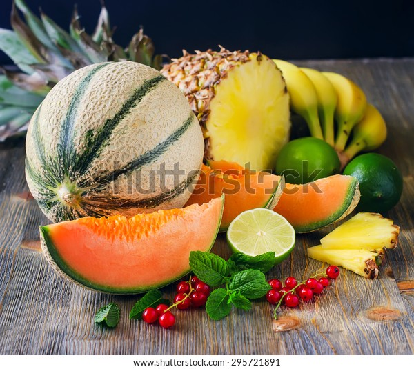 Fresh healthy tropical fruits, melon, pineapple, berries. Summer food, vitamins concept
