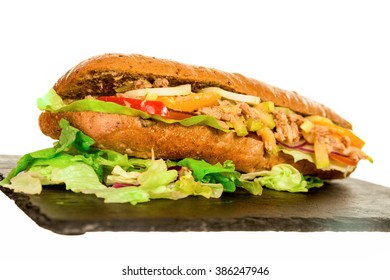 Fresh Healthy Tuna Sandwich Baguette with Vegetables. Home Made on Black Dish Plate, Ready to Eat. Brazilian Beirut. Bread with Fish Meat with Various Ingredients, Tasty Energy Meal for Athletes.