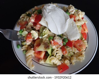 fresh healthy vegetable pasta salad served as a cold dish - Shutterstock ID 1932920612