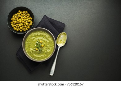 Fresh healthy vegetable pea soup overhead shoot