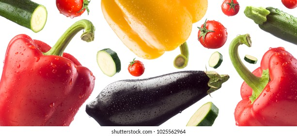 Fresh healthy vegetables falling on white background, healthy eating concept