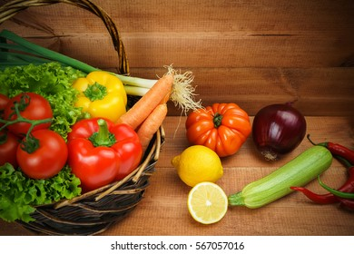 Fresh and healthy  vegetables on the wooden background.