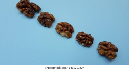 fresh healthy wallnuts on blue background