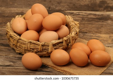 Fresh hen eggs on a old wooden table. Rustic style,