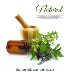 Fresh herbs and medical oil bottle