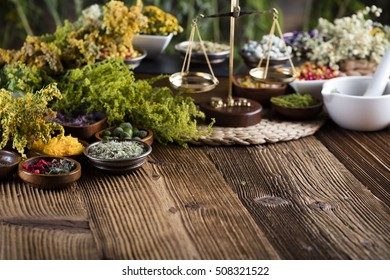 Fresh herbs. Natural medicine. Wooden table mortal.