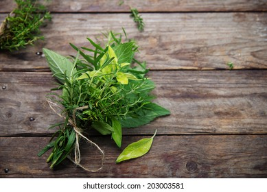 Fresh herbs on rustic wooden planks