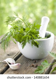 Fresh herbs in the pestle, selective focus