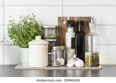 Fresh herbs and spices in clean, modern kitchen