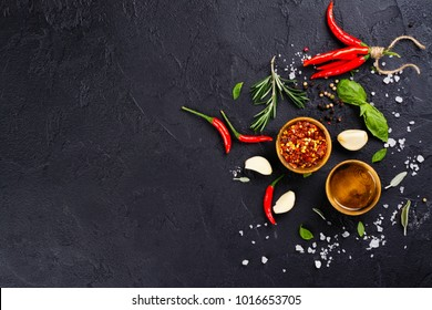 Fresh herbs and spices on black stone table. Cooking concept. Copy space