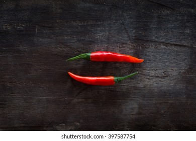Fresh herbs and spices on a dark wooden background