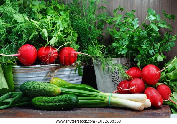 Fresh herbs and vegetables in the kitchen on a wooden table