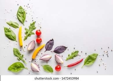 Fresh herbs with vegetables and spices on white background