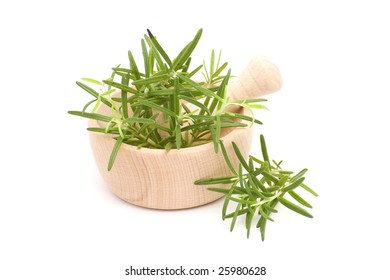 fresh herbs and wooden mortar