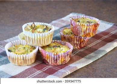 Fresh home cooked egg muffins, quiche or frittata. Baked eggs with meat and vegetables.