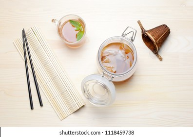 Fresh home made Kombucha fermented tea on a wooden background