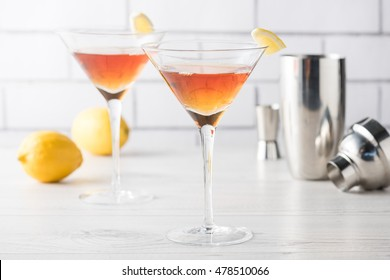 Fresh home made Manhattan cocktails with lemon and maraschino cherry