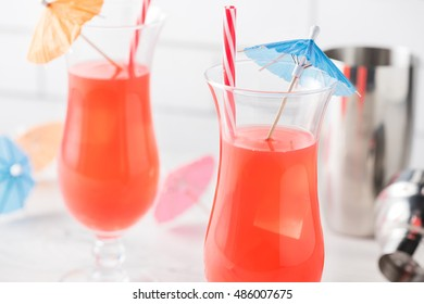 Fresh home made Singapore Sling with cocktails umbrella