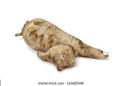 Fresh homegrown parsnip on white background