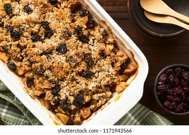 Fresh homemade baked apple, cranberry and oatmeal crumble or crisp in casserole dish, photographed overhead
