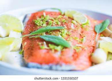 fresh homemade baked salmon with lime and herbs