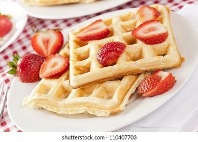 Fresh Homemade Belgium Waffles with Strawberries on top