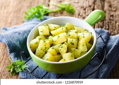 Fresh homemade boiled potatoes with parsley in bowl (Selective Focus, Focus in the middle of the image)