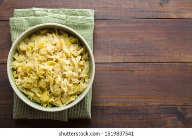 Fresh homemade braised white cabbage in bowl, photographed overhead with copy space on the right side (Selective Focus, Focus on the dish)