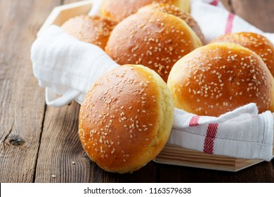 Fresh homemade burger buns with sesame.