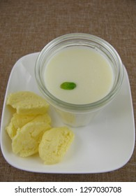Fresh homemade butter and buttermilk in a glass