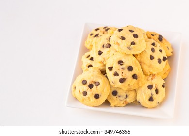 Fresh Homemade butter cookies with chocolate-chips on white ceramic square-shaped plate