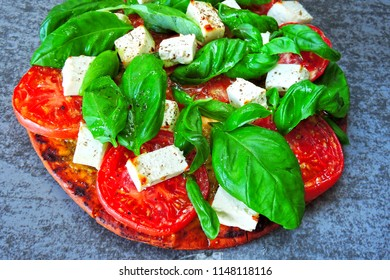 Fresh homemade caprese pizza. Caprese cooking pizza.