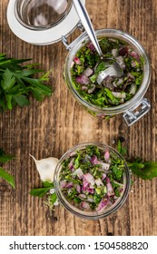 Fresh Homemade Chimichurri as detailed close-up shot (selective focus)