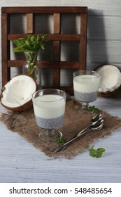 Fresh homemade coconut yogurt in glass cups served with fresh berries