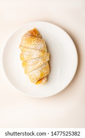 Fresh homemade croissant on plate