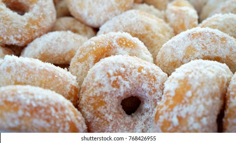Fresh homemade doughnut, coated with sugar ready to be eaten.