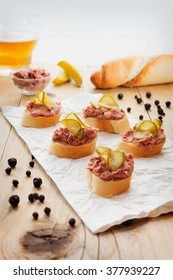 Fresh homemade fingerfood with pate and pickles