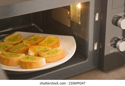 Fresh homemade garlic bread in microwave oven