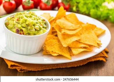 fresh homemade hot guacamole with tortilla chips