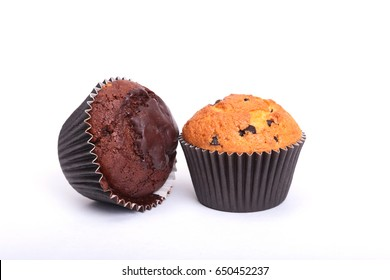 Fresh homemade muffins on white background. Top view.
