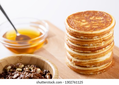 Fresh homemade pancakes with nuts and syrup