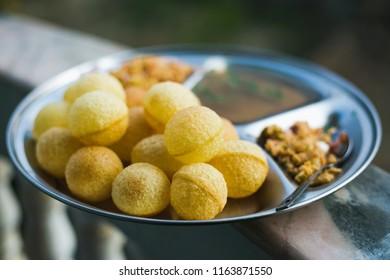 Fresh Homemade pani puri, golgappa with Tamrind Sauce.Famous Indian Nepali Snacks.
