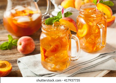 Fresh Homemade Peach Sweet Tea with Mint