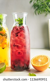 Fresh Homemade Red Berry Sangria with Wine, Raspberry, Cranberry, Lingonberry, Strawberry, Mint and Ice. Refreshment Fruit and Berries Iced Tea, Cocktail, Punch or Compote in Tall Bottle Close Up